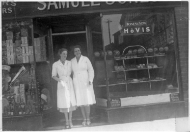 Staff outside Samuel Jones and Son, new shop