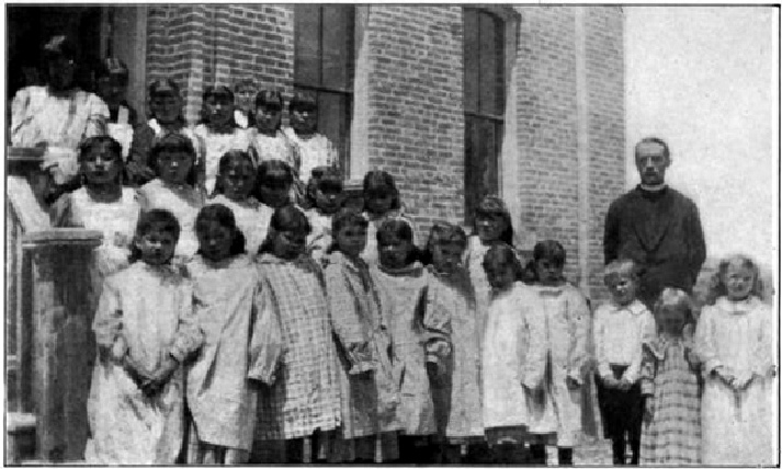The Reverend John Roberts, born in Dyserth, with students at the Mission School, approx. 1906.