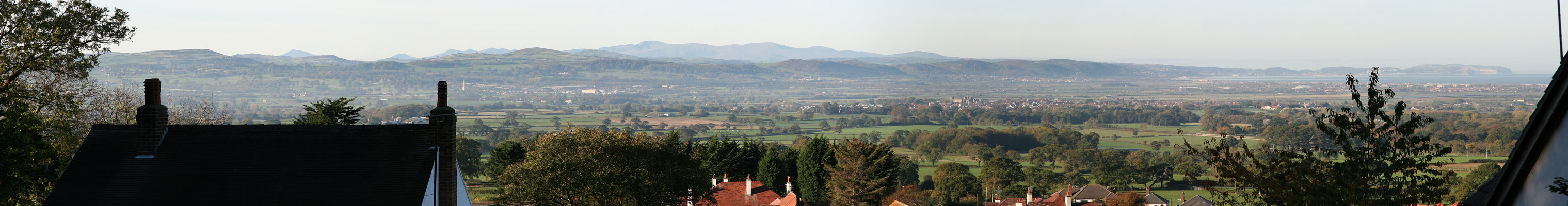 Panorama from Gibbs' Wood (Foel Wood), Dyserth, over the Vale of Clwyd towards Snowdonia